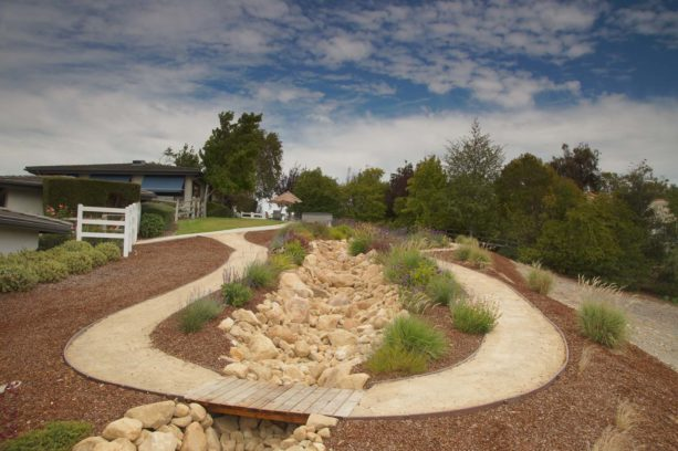 rustic style backyard with gravel path landscape to get the desert look