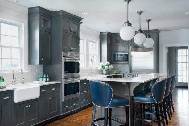 blue gray bronze kitchen cabinets combined with beveled subway tile