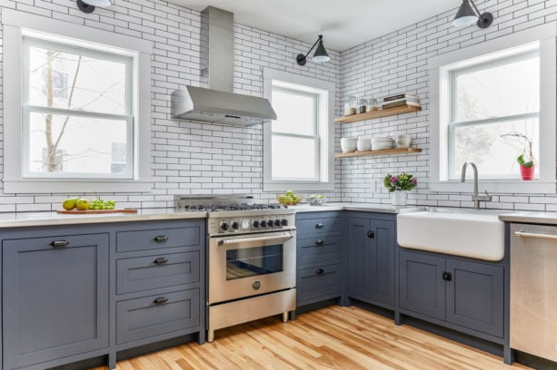 blue gray cabinets combined with concrete countertops in a lovely kitchen