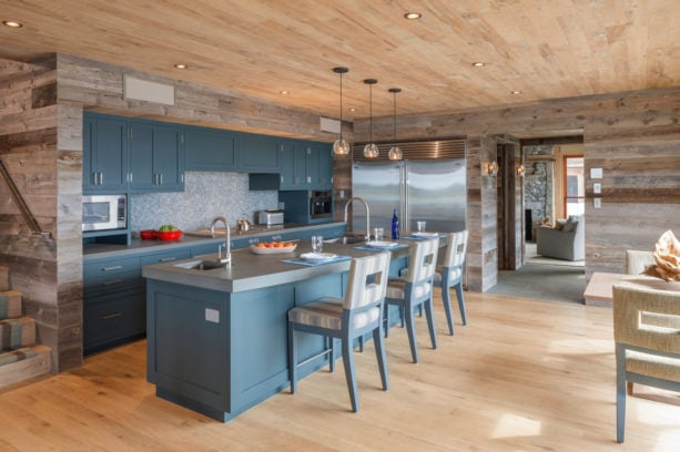 blue gray cabinets with bluestone countertops in a modern rustic kitchen