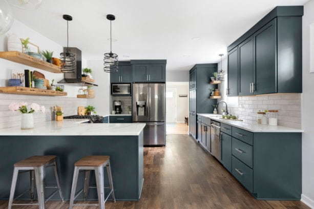 combination of blue gray kitchen cabinets with marble-like quartz countertops