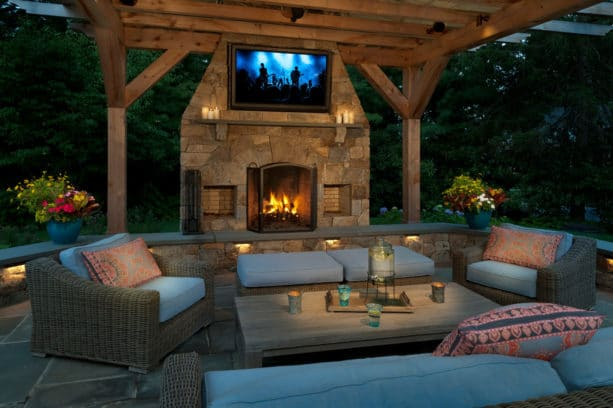 contemporary patio with outdoor stone fireplace and tv
