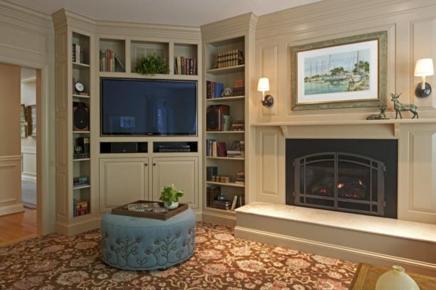white wall unit with polished black fireplace