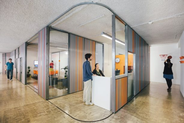 corrugated metal garage doors used to create flexible moveable office walls
