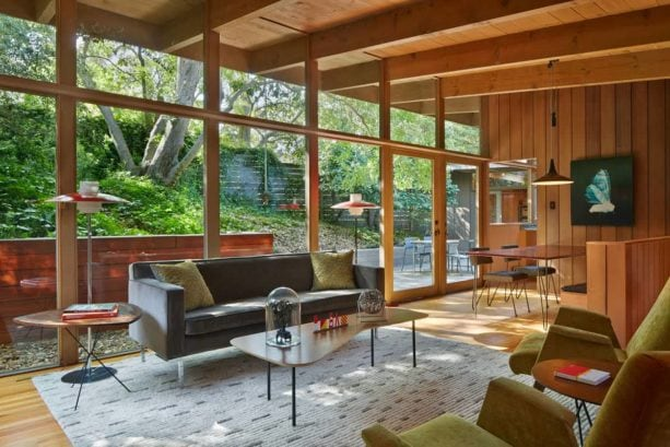 open-style mid-century modern living room with clear-finished solid oak floor