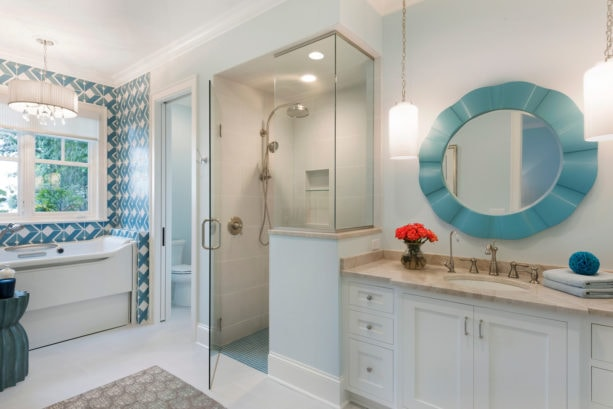 an elegant master bathroom with Tosca colored mirror in the blue and white color scheme