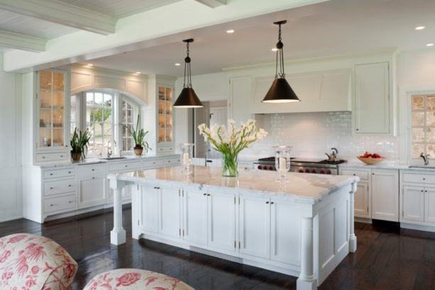 arched windows over an undermount sink in a traditional kitchen