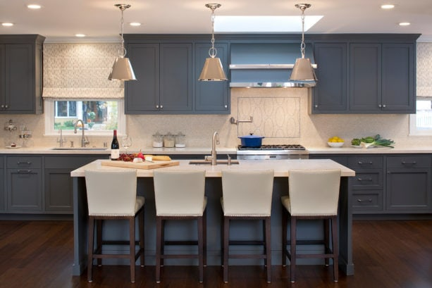 blue gray color kitchen cabinets with dark stain oak floor