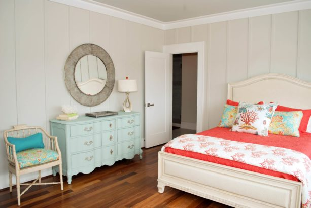 a coral and light blue beach-style bedroom