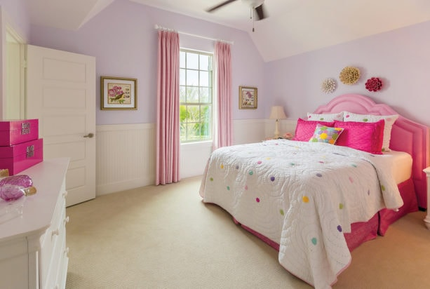 a girl's bedroom with the combination of soft purple and bright pink