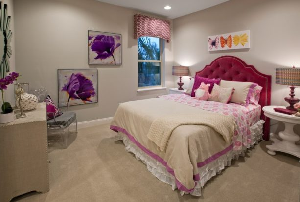 a cozy contemporary girl's bedroom with pink, purple, and light tan color scheme