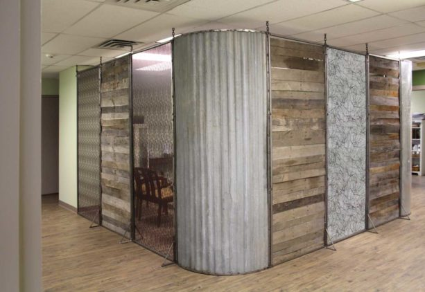 the use of corrugated metal wall in a modern rustic clinic interior