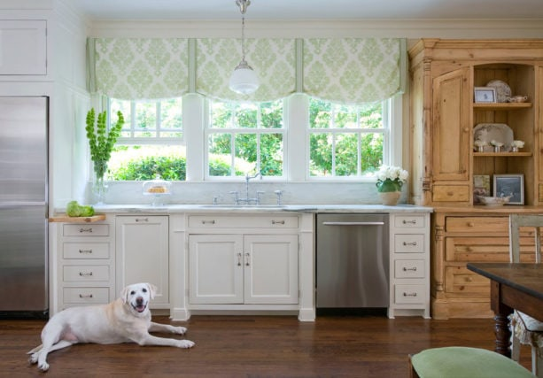 vintage kitchen with a cast iron sink and triple hung windows over