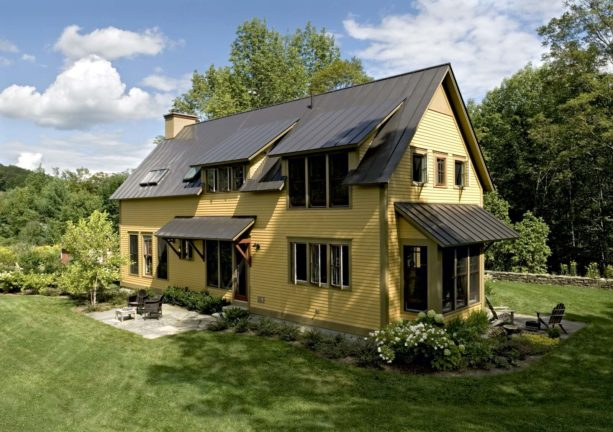 yellow and olive house color combination with metal roof