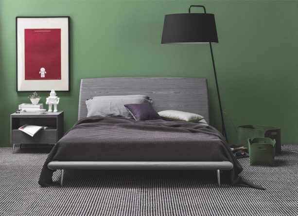 a minimalist contemporary bedroom that looks bold with dark gray and green colors