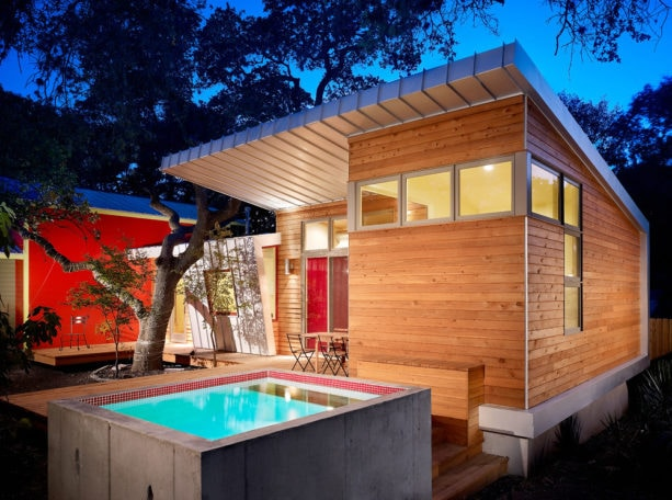 galvanized metal roof house mixed with red color and stained cedar siding combination