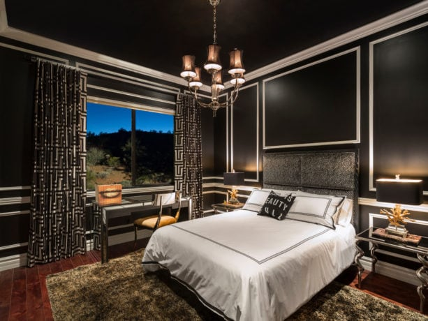 a contemporary bedroom with black, white, and gold color theme