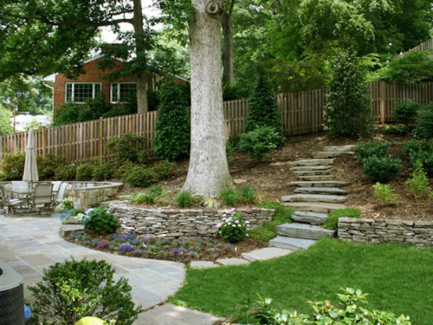 ideas of retaining wall and stone path in steep slope backyard