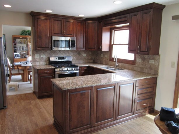small traditional u-shaped kitchen with a peninsula and cherry cabinetry