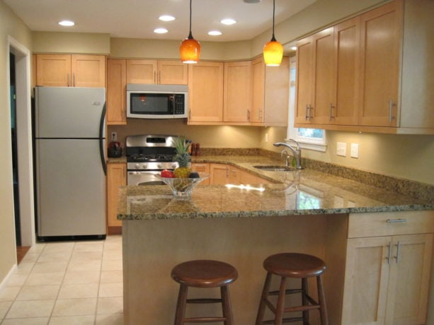 u-shaped transitional kitchen with ceramic tile and a peninsula
