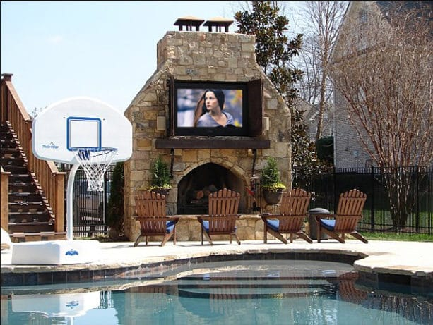large outdoor fireplace completed with a weatherproof 65 inch tv