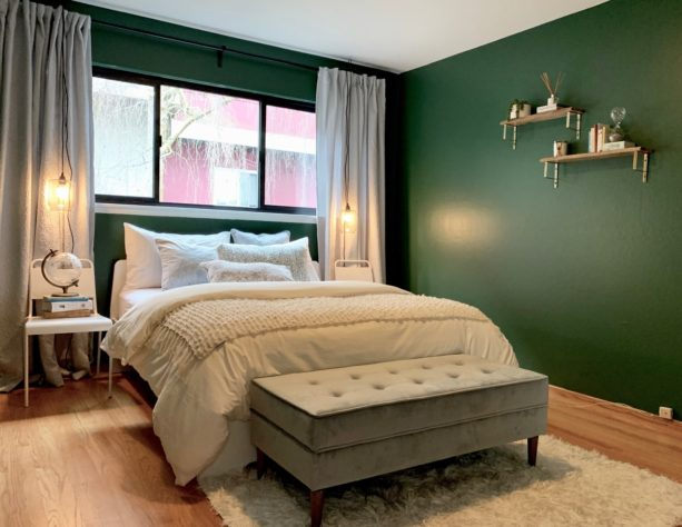 a nice, contrasting look from light gray curtains and dark grey wall combination