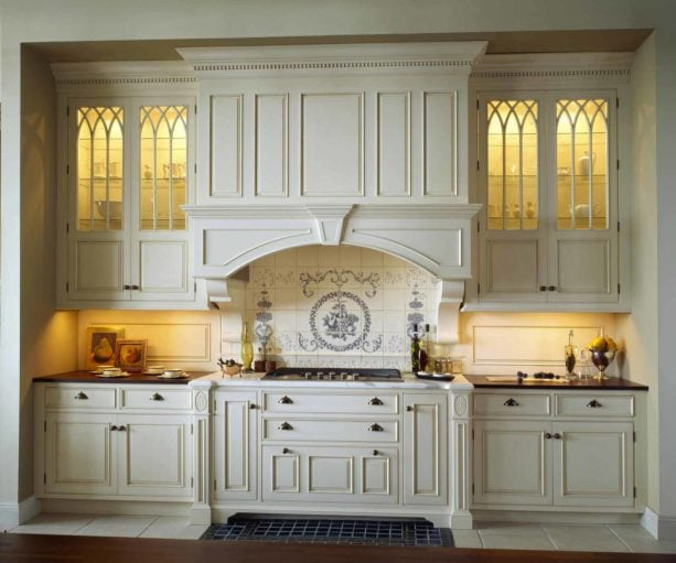 multicolored discovertile backsplash behind stove only in a french style kitchen