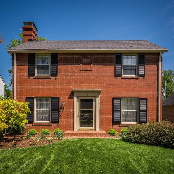 black shutters for orange brick house