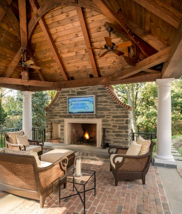 timber framing pavilion with wide fireplace and tv