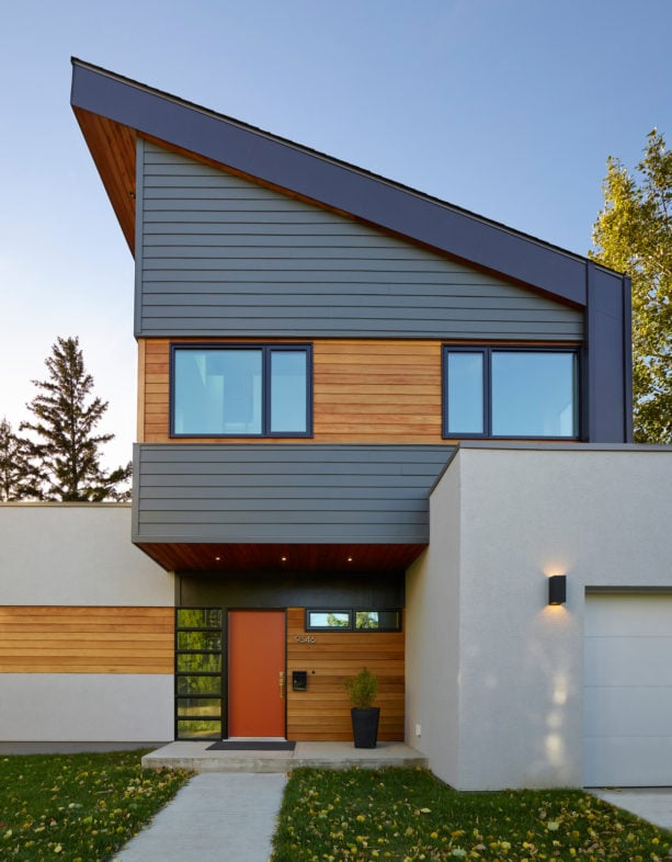 iron gray hardie plank with clear cedar color combination with metal roof house