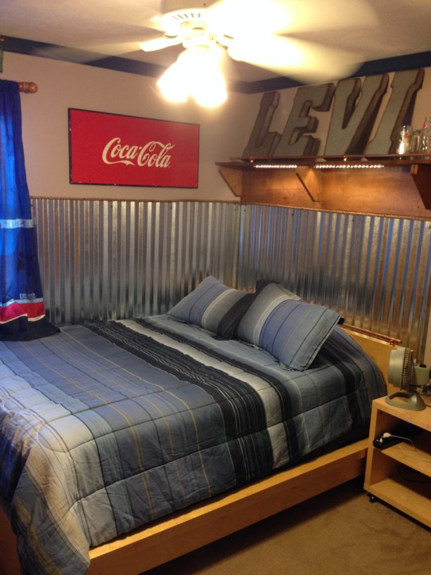 industrial boy's bedroom with corrugated metal wainscoting