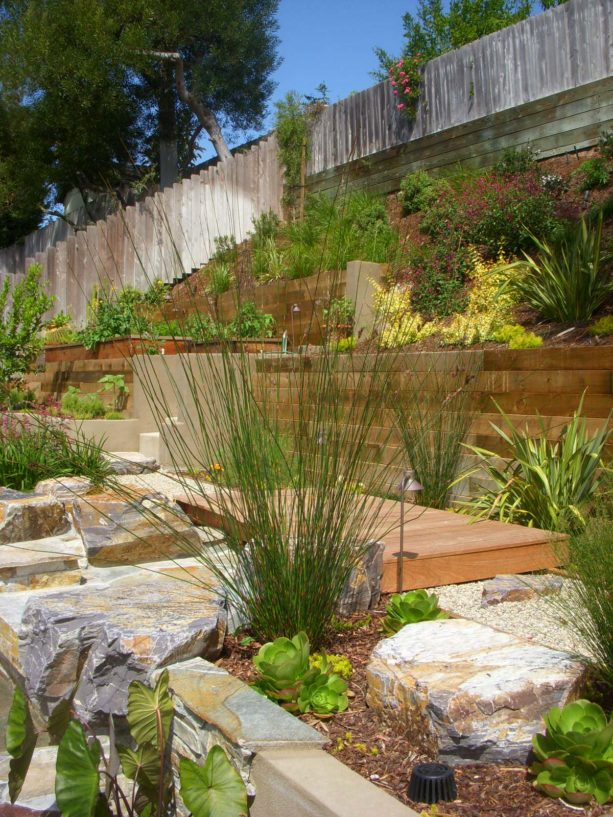 modern hillside retaining wall with planted steep slopes