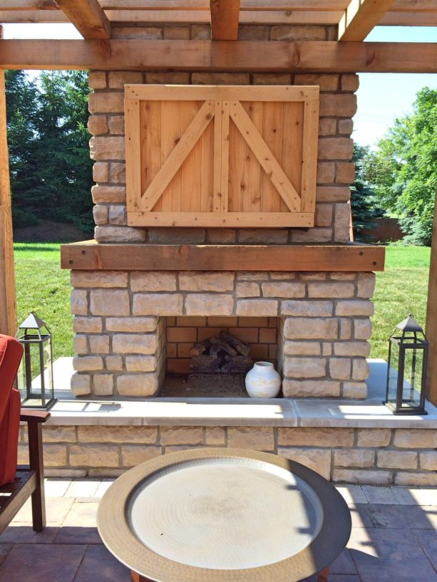 rustic style outdoor fireplace with custom tv cabinet