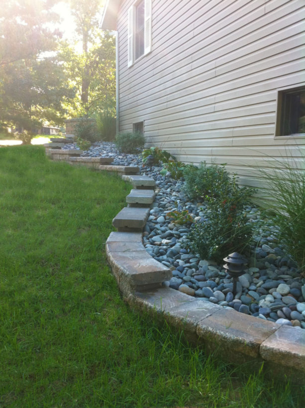 stepped retaining wall ideas down the gradual steep slope