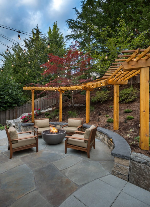 retaining wall doubles as overflow seating area in steep slopes