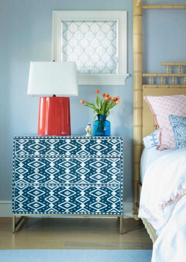 a unique bedside table with coral lamp on it