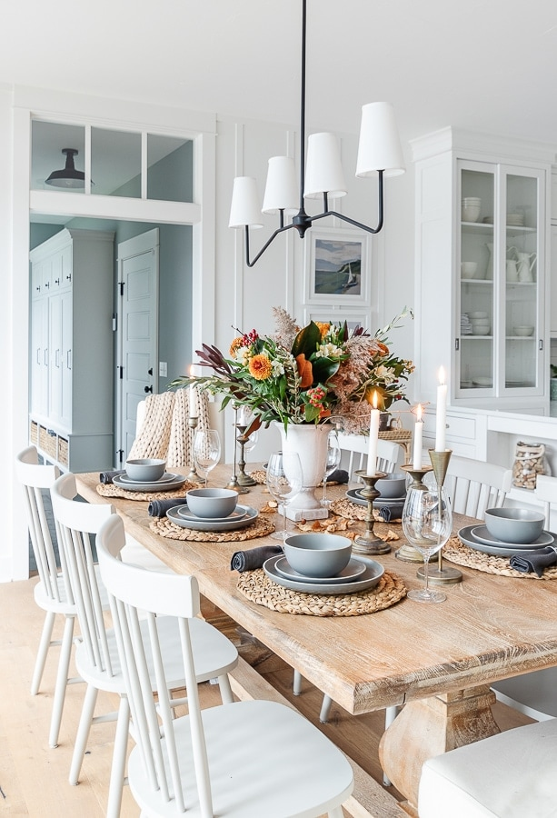thanksgiving table flowers rattan and gray dishes