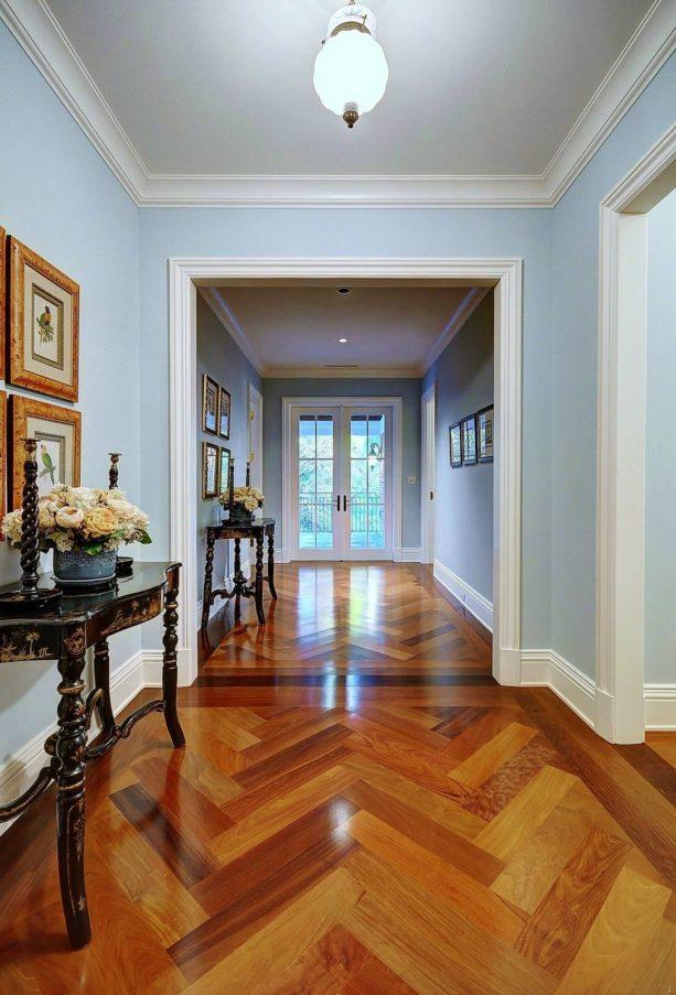 a glamor traditional hall with polished Brazilian walnut floor and white trim