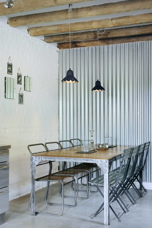 industrial feel from corrugated metal accent wall in a contemporary dining room