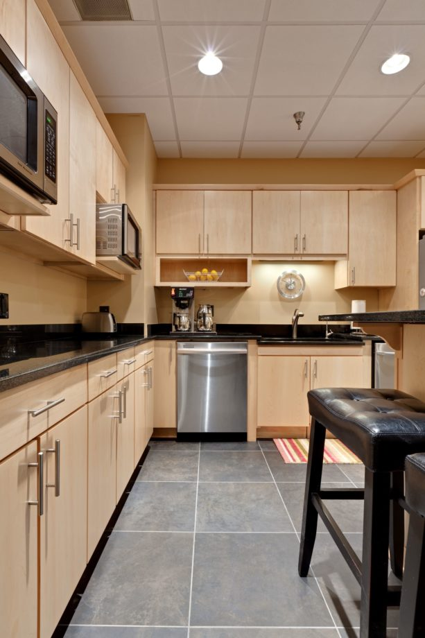 a contemporary kitchen with natural-finished maple cabinets and Napery wall paint