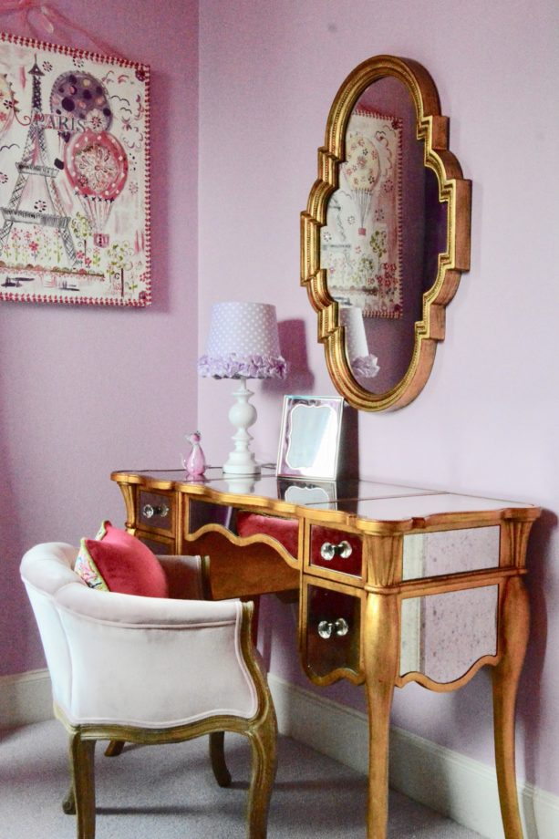 the gold dressing table in the corner of the room