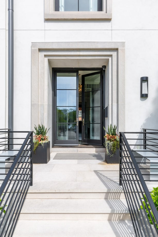 a contemporary front door with riffled-style trim