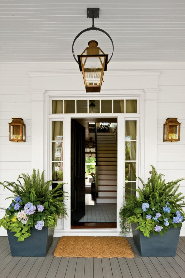 trim with decorative details in a black front door design with transom and sidelights