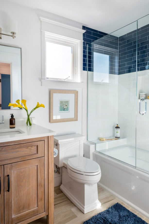 a beach-styled bathroom with a beautiful combination of blue and white tiles