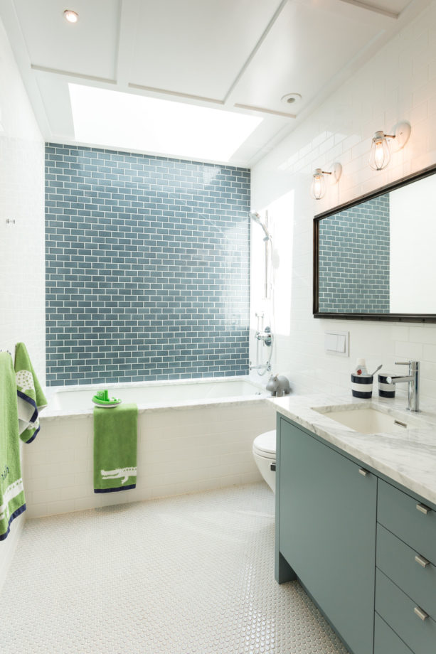 a contemporary bathroom with teal blue tile and white wall to achieve a minimalist look