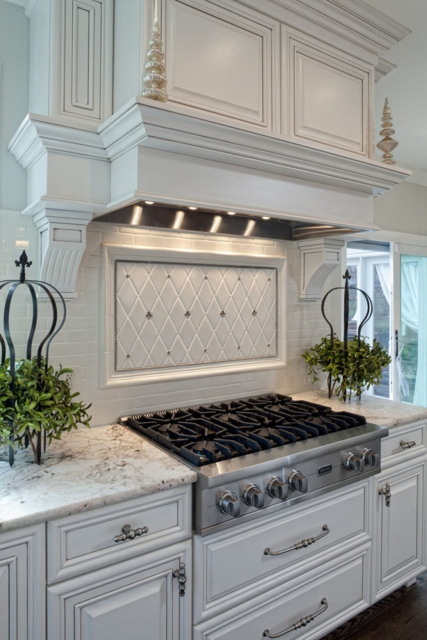 diamond shaped white tile with silver lining backsplash behind stove only