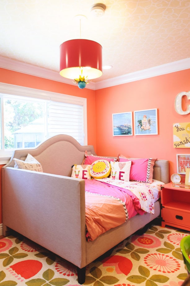 a transitional multicolor girl's bedroom in coral pink and soft purple color