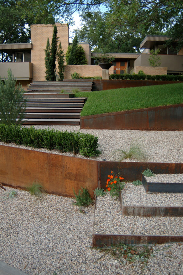 contemporary metal retaining wall landscape ideas with stoned steep slopes