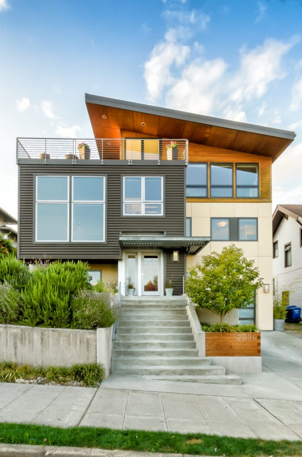 beige, metal, and natural wood house color combination with a shed metal roof