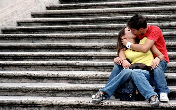 In-love couple kiss on the stairs